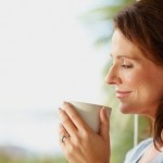 Happy woman holding a coffee cup